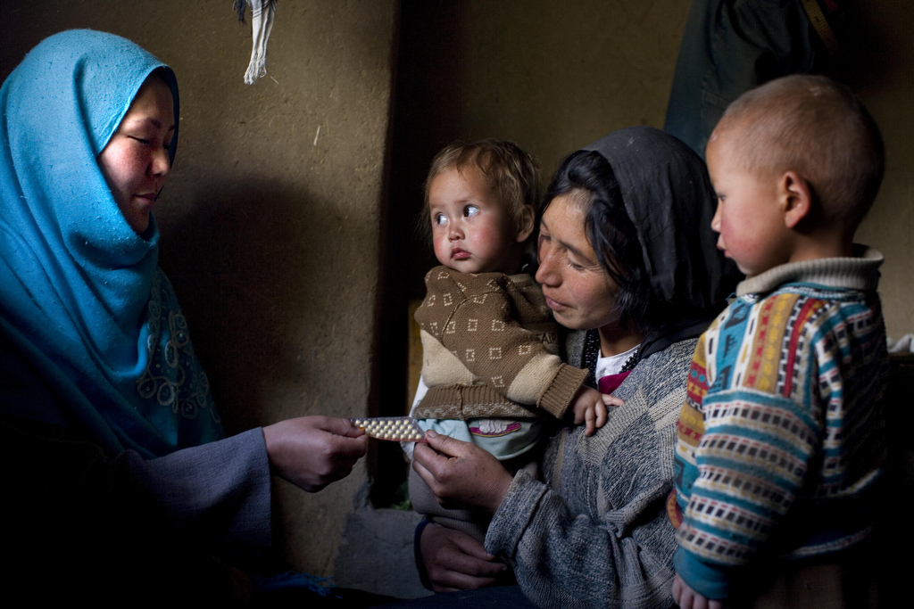 U.S. Agency for International Development (USAID)-supported frontline health worker Ozara Husseini (left) talks to Najiba, who has five children, about the advantages of family planning and Najiba's decisions to start taking the pill at their home in Katasank near Bamyan, Afghanistan, on the June 8, 2010. Courtesy Kate Holt/Jhpiego.