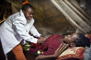 A frontline health worker in rural South Omo, Ethiopia, examines a pregnant woman. Photo Credit: AMREF