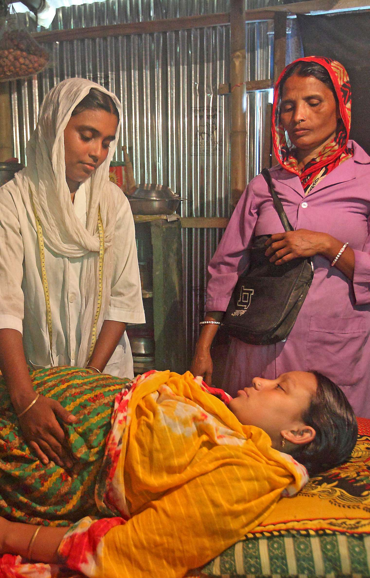 The patient, pictured here with a birth attendant and a community health worker, is an active participant in her own well-being. Photo courtesy: BRAC