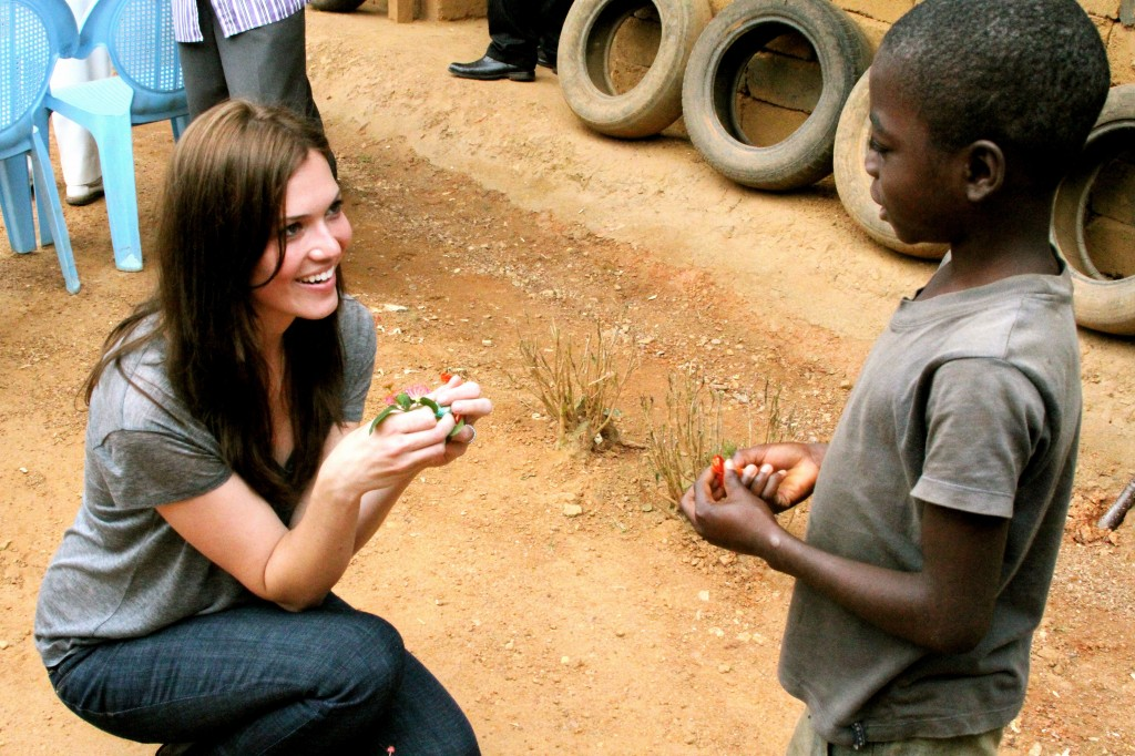 PSI Ambassador Mandy Moore visits with the patient of a community health worker in a small village in Cameroon. Courtesy PSI.