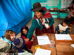 A qhali teaches schoolchildren about vitamins Photo credit: Vitamin Angels
