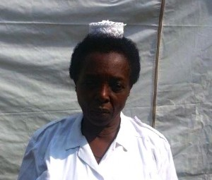 """""""Teamwork has enabled us to improve our performance"""" – Sr. Rwabwogo, HIV counseling and testing In-charge nurse at Fort Portal Regional Referral Hospital. Courtesy URC/USAID SUSTAIN."""