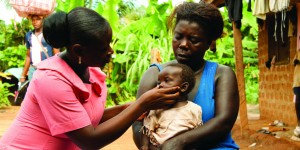 CHW performing routine check-up on an infant in Senegal. Courtesy, 1mCHW Campaign.