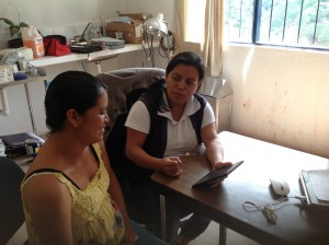 A CES health worker field tests the app with a patient. Courtesy Hesparian Health Guides.