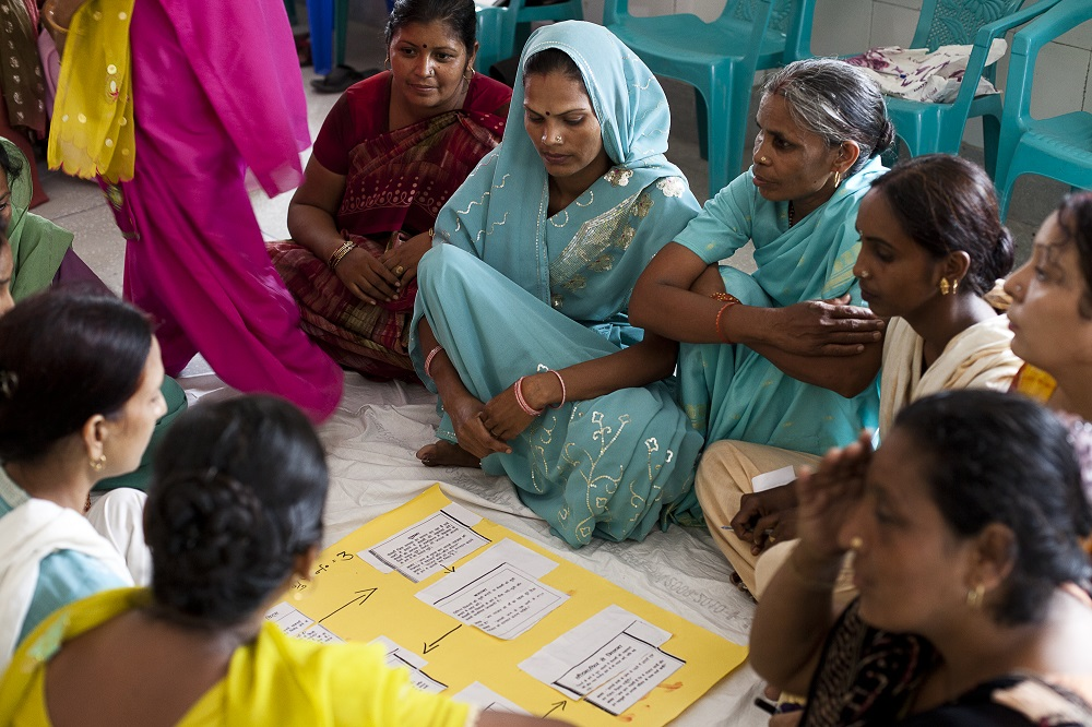 At a monthly Accredited Social Health Activist (ASHA) meeting at Sunhati Khadkhadi community health center, ASHAs conduct a group exercise and present their findings about handling newborn babies. ASHAs are effective at communicating and changing behaviors at the community level because they are from communities they serve. Photo by Trevor Snapp, IntraHealth International