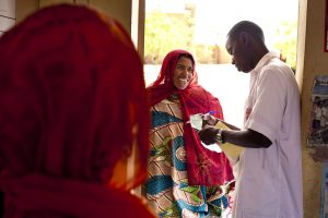 A pharmacist delivers drugs at a clinic in Mali. Photo by Trevor Snapp, IntraHealth International